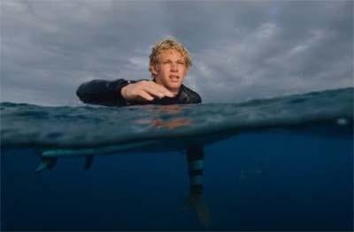 Surfer John John Florence paddling.